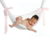 Baby in pink ribbon hammock