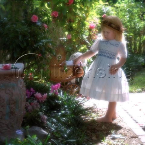 Girl with watering can watering the roses